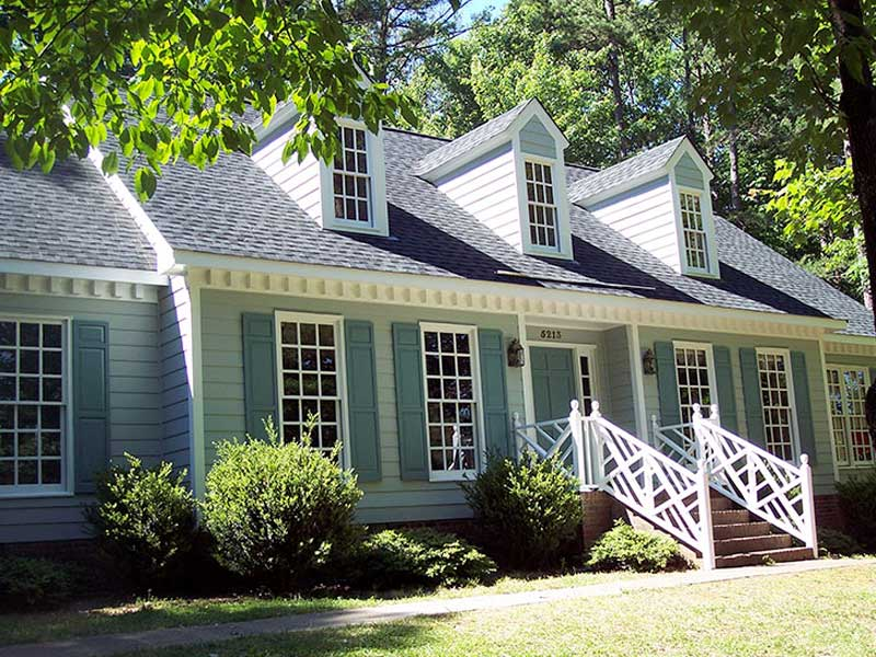 exterior-painting-after-photo-light-green-blue-home