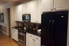Cabinet refinishing project by your exterior painter in Raleigh