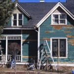 scraping a house before exterior painting