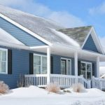 House in the winter with blue exterior paint